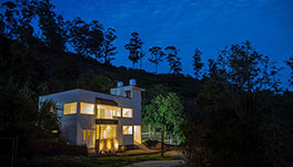 Petra Family Guest House, Valparai- Front View at Night -1